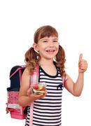 happy little girl holding healthy lunch for school - stock photo