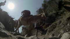 2.7K. Mules carrying gas cylinders, Nepal. Full HD. 2704x1524 Stock Footage