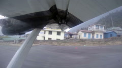 2.7K. Take off on the plane from Lukla, Nepal. Airplane wing out of window Stock Footage