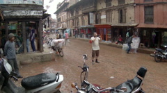 Tourists are hiding from the rain in Bhaktapur, Nepal. Full HD, 2704x1524 Stock Footage