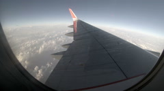 2.7K. Airplane wing out of window on blue sky background, Full HD. 2704x1524 Stock Footage
