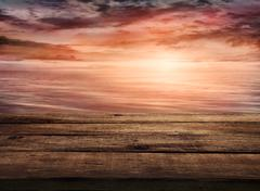 Wood table and tropical sunset landscape in the background. summer background Stock Photos