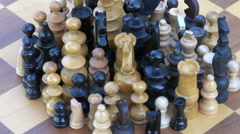 rotate various wooden chess pienes on  ancient chessboard - stock footage