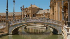 Bridge and canal at spain square (plaza de espana) in the maria luisa park, i Stock Footage