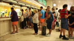 People queueing to buy tickets Stock Footage