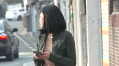 Seoul - Woman using phone Stock Footage