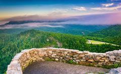 low clouds over the appalachian mountains at sunrise, seen from devil's court - stock photo