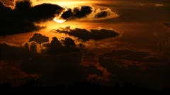 Large Sun setting behind dramatic clouds - 1 Stock Footage