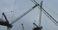 Stock Video Footage of Plane over moving cranes 4K