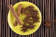 Cinnamon on green plate Stock Photos