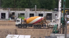 New house building work place panorama with cement mixer and workers Stock Footage