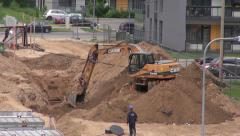 Heavy machnery excavator dig ground in building work place Stock Footage