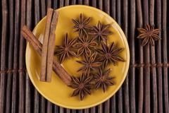 Cinnamon on yellow Stock Photos