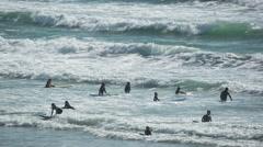 Polzeath cornwall coast beach surfers sport Stock Footage
