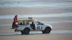 Cornwall coast beach life guard sport surfers Stock Footage