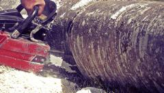 Man sawing wood chainsaw, vintage Stock Footage