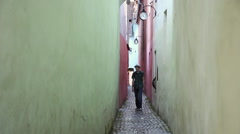 Tourist walking on very narrow old street, Europe, medieval town Stock Footage