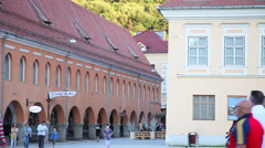 People walking in central square, medieval town, architecture, Europe Stock Footage