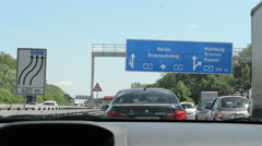 Traffic jam on A2 motorway (Germany) with direction sign for Berlin Stock Footage