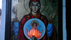 Virgin Mary with child, Baby Jesus, Orthodox icon on street wall, faith Stock Footage