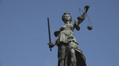 Lady Justice statue famous Frankfurt am Main German landmark blue sky metal day Stock Footage