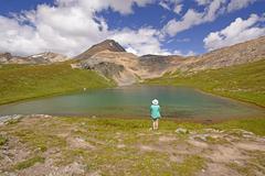 hiker enjoying an alpine view - stock photo