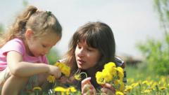 Mom and daughter holding bouquets in their hands - stock footage