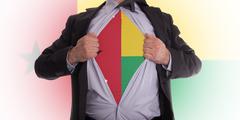 businessman with guinea-bissau flag t-shirt - stock illustration