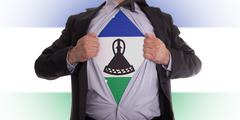 businessman with lesotho flag t-shirt - stock illustration