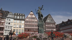 Römer square Lady Justice statue medieval facade Frankfurt am Main Germany day Stock Footage
