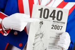 Stock Photo of patriotic: holding instructions for 1040 tax form