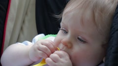 10 Blue eyed baby chewing on a spoon Stock Footage