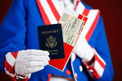 Stock Photo of patriotic: holding a passport and airline ticket