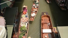 Beautiful high angle slow motion shot of various boats at the floating market Stock Footage