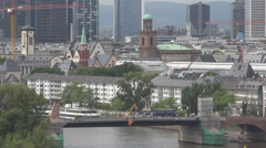 Aerial view traffic car street bridge Frankfurt am Main river rooftop church day Stock Footage