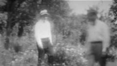 Man Walks In Garden - Vintage 8mm - stock footage