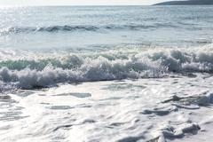 splash of seawater with sea foam and waves - stock photo