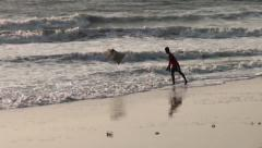 One young man throwing into the sea a bag of garbage Stock Footage