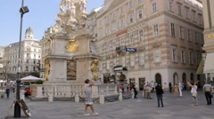 The Pestsäule with people around in Graben street Stock Footage