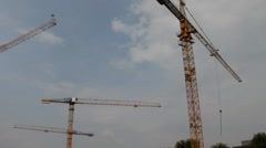 Tower cranes are working on the construction of residential building Stock Footage