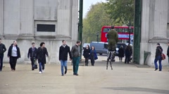 People commuters and entertainers at hyge park corner Stock Footage