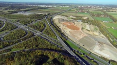 Aerial view of highway junction and gravel pit Stock Footage