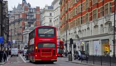 London people commuters and traffic at harrods corner Stock Footage