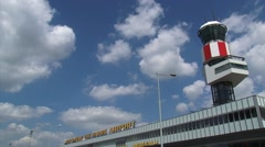 ROTTERDAM THE HAGUE AIRPORT - air traffic control tower + tilt down Stock Footage
