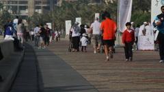 Doha Qatar People Walking Along Al Corniche Stock Footage