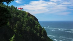 Lone house on cliff overlooking ocean Stock Footage
