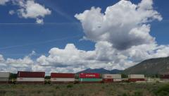 Landscape with Trains and Clouds Stock Footage