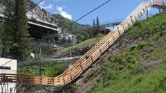 Thrill slide ride summer mountain resort 4K 330 Stock Footage