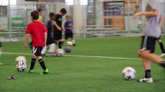Stock Video Footage of Soccer Training Practice with Kids dribbling the ball and working on foot work