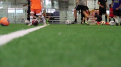 Low angle slider shot showing Soccer Training Practice with kids Stock Footage